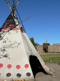 Tepee and Fort. Canvas tepee and Hudson's Bay Company fur trading fort (c. 1860). Heritage Park, Calgary, Alberta, Canada Royalty Free Stock Photography
