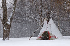 Tepee in the snow. Indian tepee in the snow during storm in quebec Stock Image