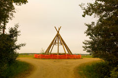 A tepee under construction in the northwest territories Royalty Free Stock Images