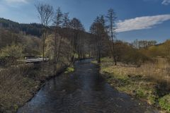 Tepla river in Teplicka village in spring morning. Tepla river in Teplicka village in spring sunny morning Royalty Free Stock Photography