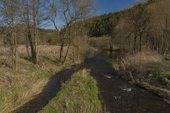 Tepla river in Teplicka village in spring morning. Tepla river in Teplicka village in spring sunny morning Royalty Free Stock Image