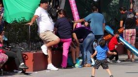A boy playing with a ballon in the public squeare. Tepotzotlan, Mexico-CIRCA June 2017: A boy playing with a ballon in the public squeare. Tourism is one of the stock footage