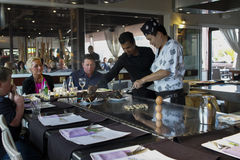 A teppanyaki chef cooking at a gas powered teppan. In a Japanese steakhouse on CC Safari, Las Americas, Tenerife, june 2015 Royalty Free Stock Photography