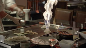 Teppanyaki chef showing off cooking skills
