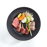 Teppanyaki Japanese and Korean Grill Meat. Preparation of raw foods for frying on teppan. Teppanyaki Japanese and Korean Grill Food - Marbled beef, rack of lamb Stock Photos