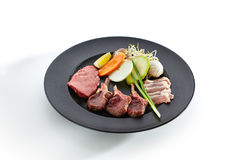 Teppanyaki Japanese and Korean Grill Meat. Preparation of raw foods for frying on teppan. Teppanyaki Japanese and Korean Grill Food - Marbled beef, rack of lamb Stock Images
