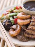 Teppanyaki- Meat and Fish Barbeque Grill. Plate of Teppanyaki- Meat and Fish Barbeque Grill with chopsticks Stock Image