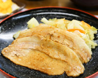 Teppanyaki Sliced Pork on Black Dish. Teppanyaki Sliced Pork in Japanese Food Court Royalty Free Stock Images