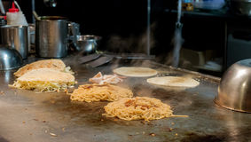 Teppanyaki Style Cooking. Teppanyaki chef cooked noodles on the table grill Royalty Free Stock Image