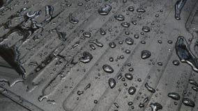 Teppichauto mit Wassertropfen Stockfotografie