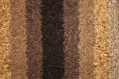 Teppichbeschaffenheit gebildet von den kleinen ledernen Stücken Stockbilder