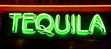 Tequila. Neon tequila label in the night. good use for party cards and posters Royalty Free Stock Photos