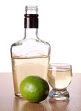 Tequila bottle and lemon Stock Photo