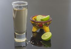 Tequila glass with lemon and salt royalty free stock images