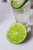 Tequila in glass on white Royalty Free Stock Photos