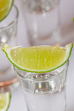 Tequila in glass on white Royalty Free Stock Photo