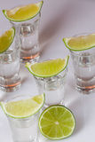 Tequila in glass on white Stock Photography