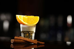 Tequila gold. Gold tequila with cinnamon sticks Stock Photography