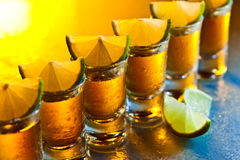 Tequila and lime on glass table Stock Images