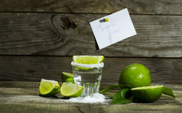 Tequila with lime and salt. On a wooden background royalty free stock photos