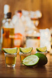 Tequila , lime and salt on wooden table Royalty Free Stock Photography