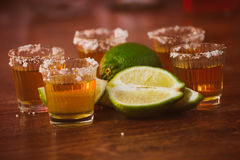 Tequila , lime and salt on wooden table Stock Photo