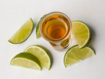 Tequila with limes stock photography