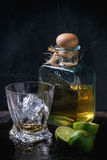 Tequila and limes Royalty Free Stock Photography