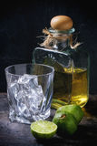 Tequila and limes Stock Photo