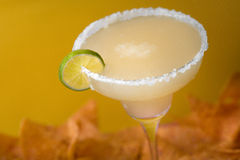 Tequila Margarita. With nachos in the background Royalty Free Stock Photography