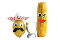 Tequila mexican glass one. Tequila glass and Mexican toys vegetables on white background Royalty Free Stock Photos