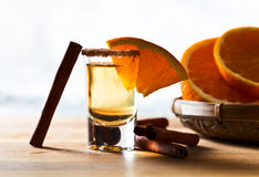 Tequila with orange and cinnamon Stock Images