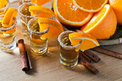 Tequila with orange and cinnamon Royalty Free Stock Image