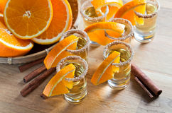 Tequila with orange and cinnamon Stock Photo