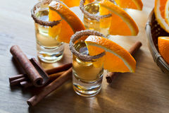 Tequila with orange and cinnamon Stock Photography