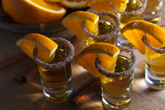 Tequila with orange and cinnamon Stock Image