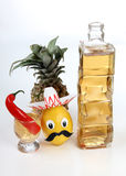 Tequila and pepper. Tequila glass and Mexican toys vegetables on white background Stock Photography