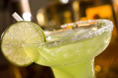Tequila on the rocks. With lime stock photos