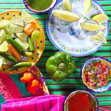 Tequila salt lemon mexican chili sauces pepper Stock Images