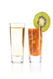 Tequila with Sangrita Chaser. Tequila Gold with Sangrita and finely chopped kiwi Chaser. Closeup shoot. Isolated over white background with reflection Royalty Free Stock Photography