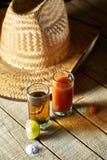Tequila, sangrita en citroen Stock Foto