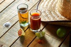 Tequila, sangrita und Zitrone Stockbilder
