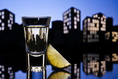 Tequila shoot in cityscape setting Royalty Free Stock Photos