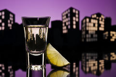 Tequila shoot in cityscape setting Stock Image