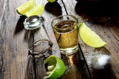Tequila. Shoot with salt and lemon slices on wooden background Stock Images