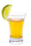 Tequila shot. Glass of Tequila with lime isolated on white Royalty Free Stock Photography