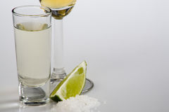 Tequila shot. A shot of aged tequila near a cup glass of extra aged tequila Stock Images
