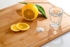 Tequila shot with fresh lemon and salt Stock Photos