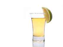 Tequila in a shot glass. Tequila shot with salt and lime Stock Images