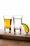 Tequila. In shot glasses isolated on white Stock Photos